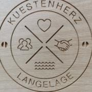 Familienlogo in Holz gefräst